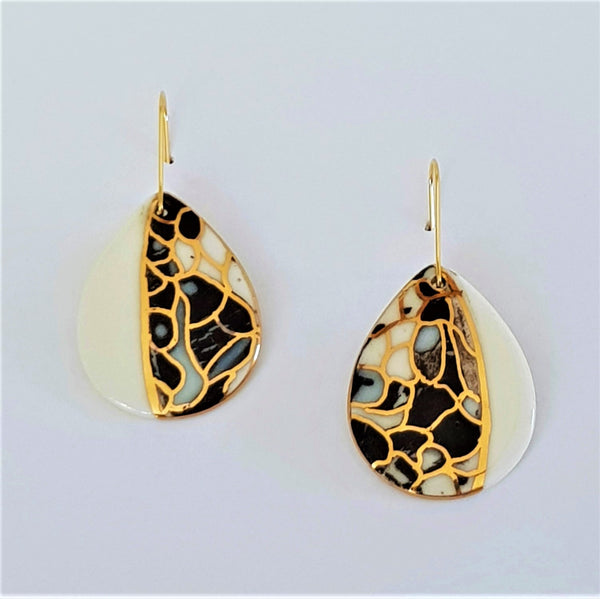 Black white and gold drop shaped earrings with unique 22 kt gold linework.