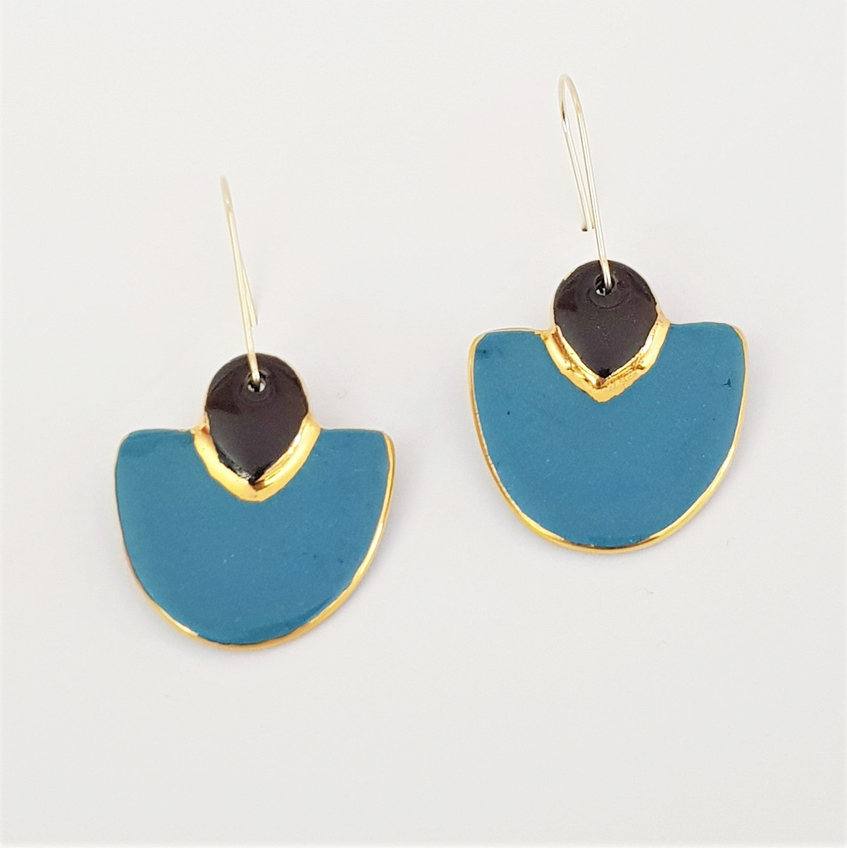 Two toned elegant drops in teal and black with gold border.