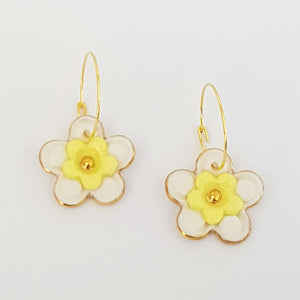 Floral Collective hoops in white and lemon.