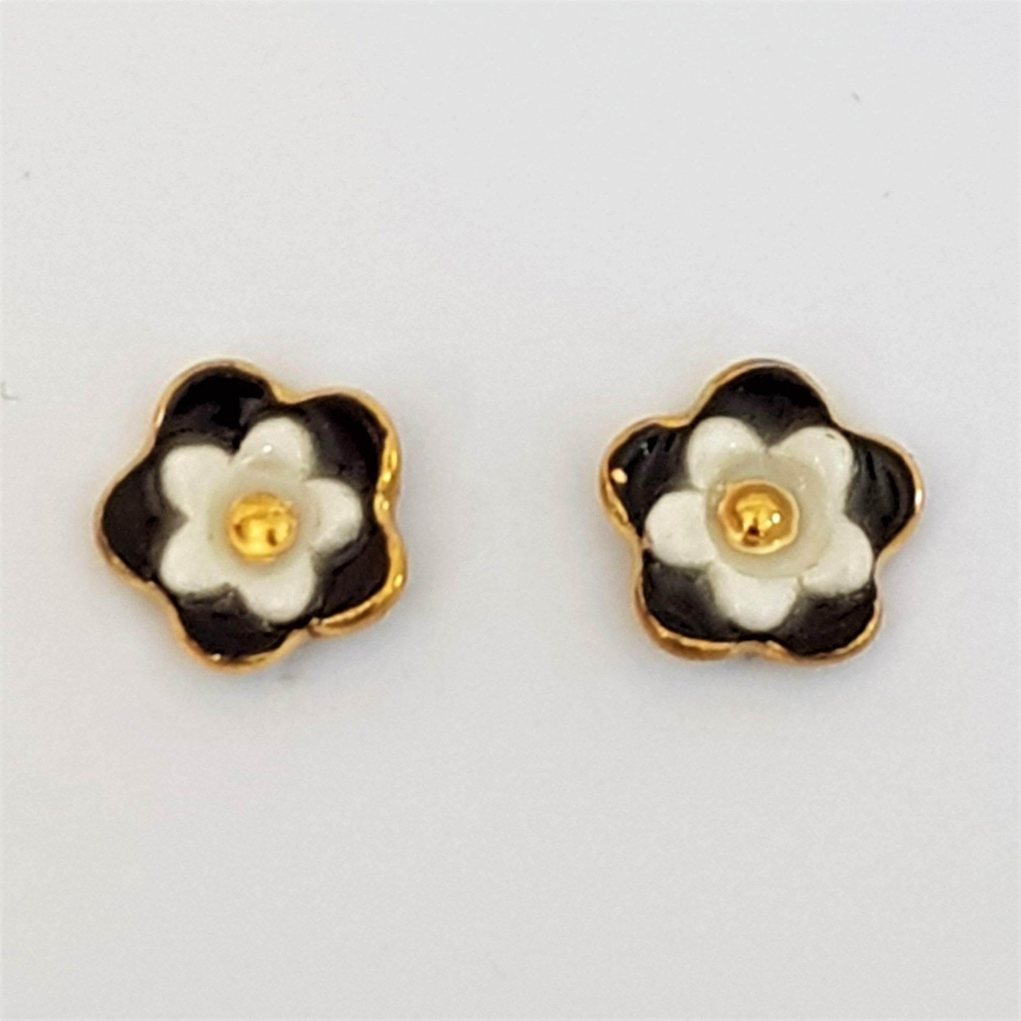 Floral collective studs in black and white.