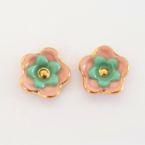 Floral collective studs in coral and teal.