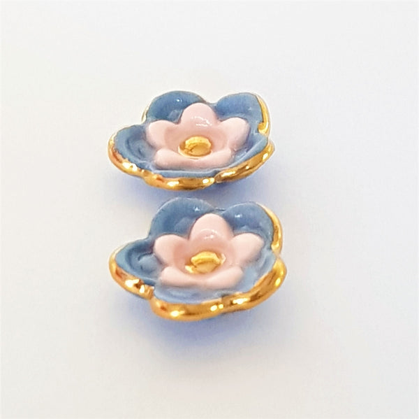 Floral collective studs in gray and pink