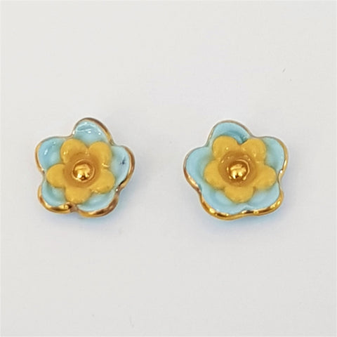Floral collective studs in light blue and mustard
