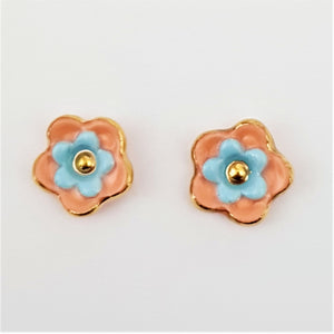Floral collective studs in mandarin and light blue.