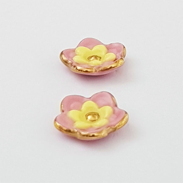 Floral collective studs in pink and lemon.