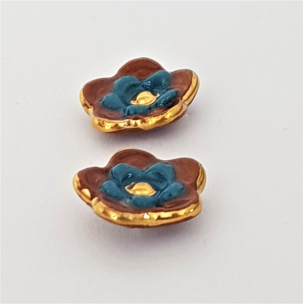 Floral collective studs in rust and pine.