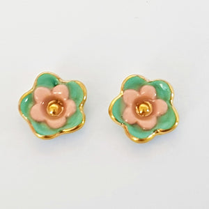 Floral collective studs in teal and coral.