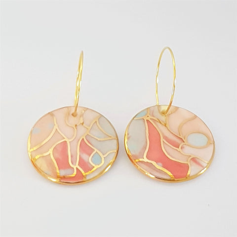 Porcelain circle drops is warm pastel tones on hoops