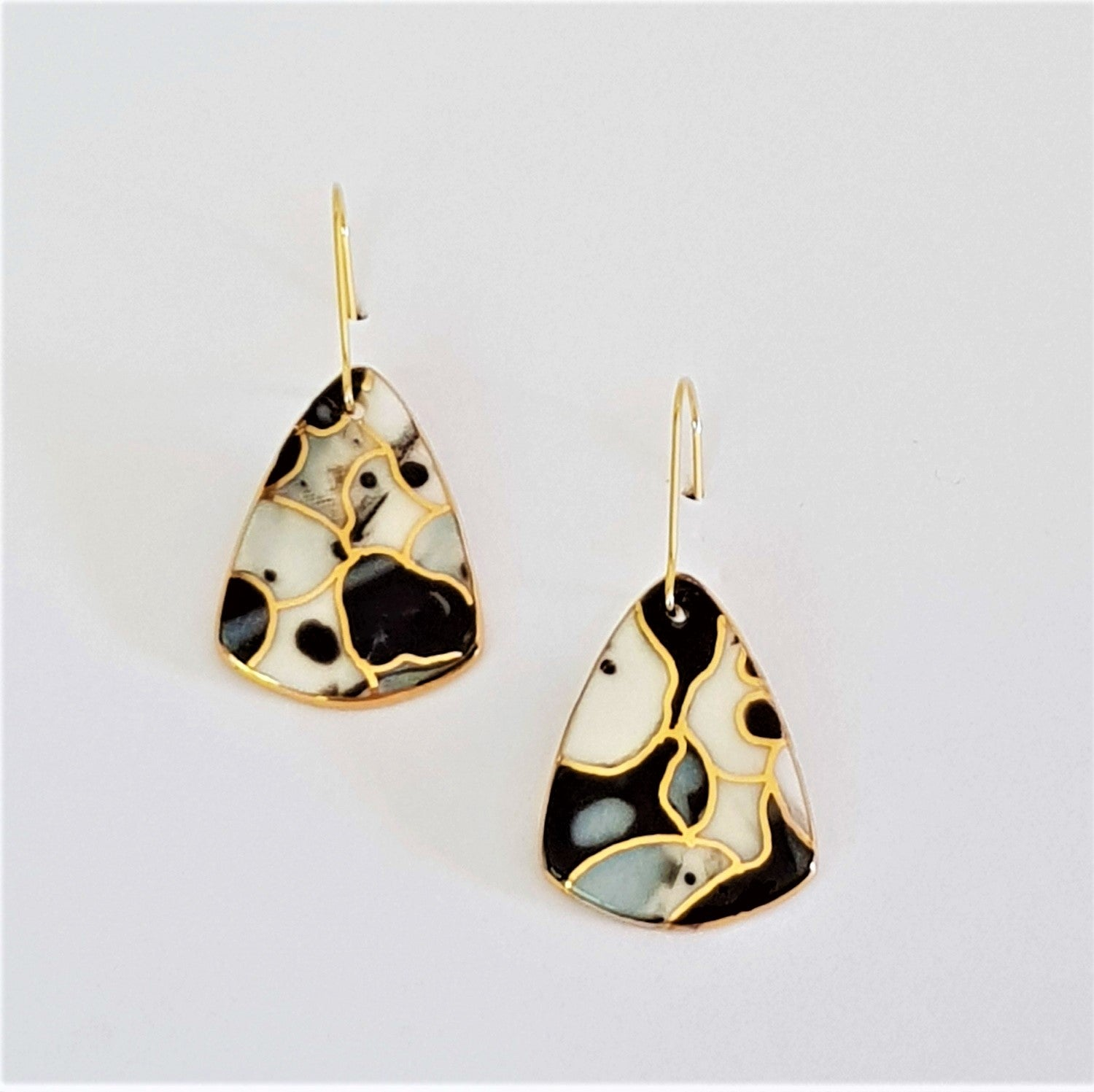 black and white mini dangle earrings with gold linework
