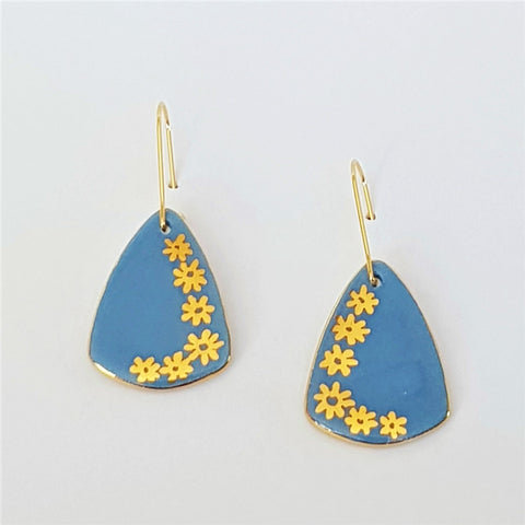 Soft blue mini dangle earrings with gold daisies
