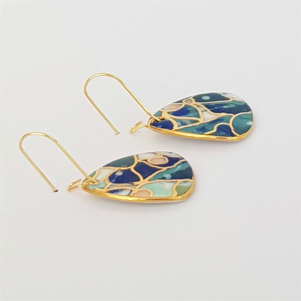 Mini dangles, teals and blues with gold highlights and edging.