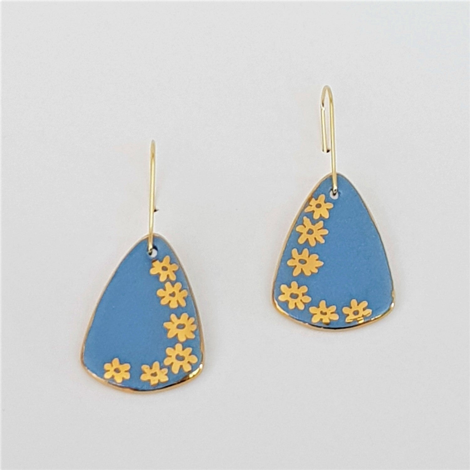 powder blue mini dangle earrings with gold daisies
