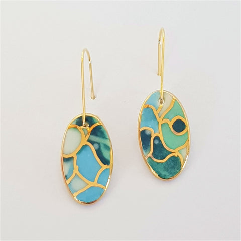 Oval mini dangles in teal and light blue tones with gold.