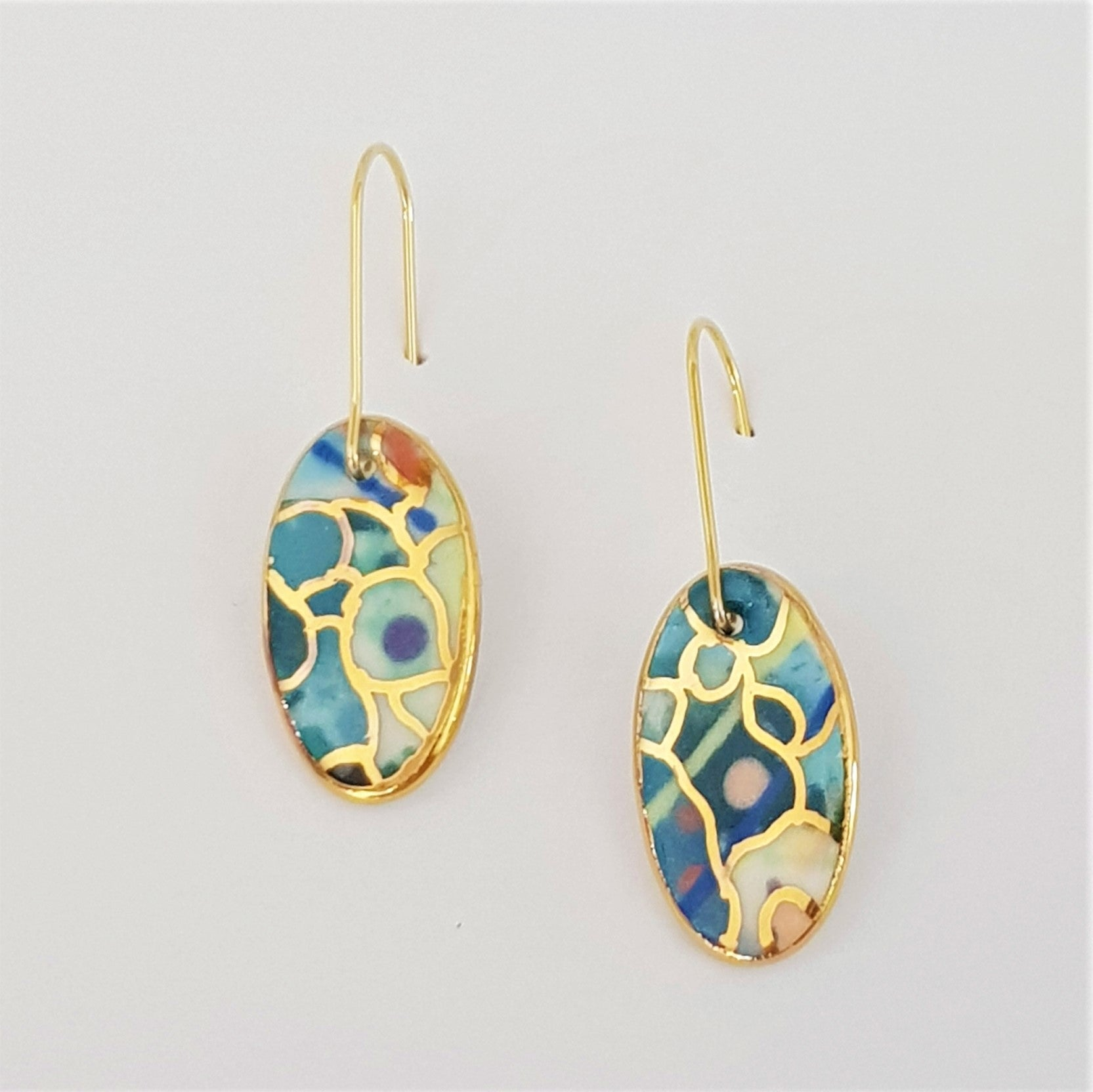 Oval mini dangles in teal and multi colours with gold.