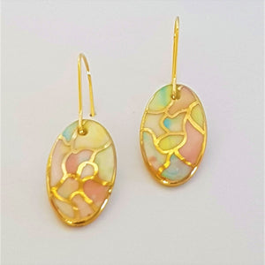 Oval mini dangles in soft pastel tones with gold.