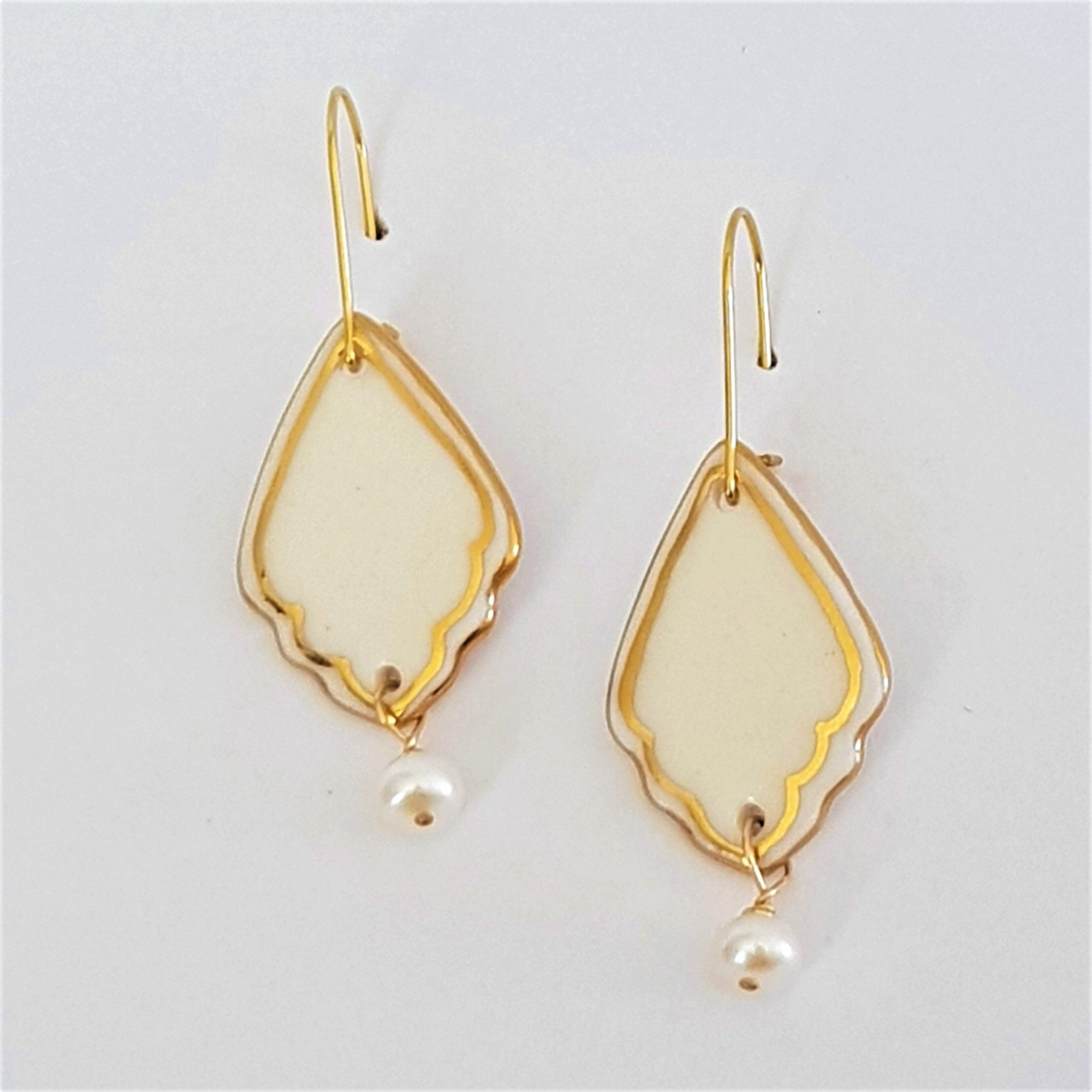 White porcelain dangle earrings with gold detailing  with fresh water pearl drop