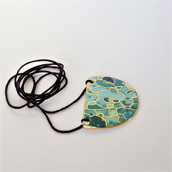 Small half moon pendant teal tones with gold linework