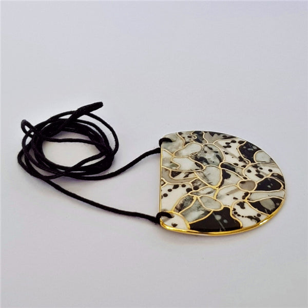 Large half-moon pendant in black, white and gray abstract with gold linework