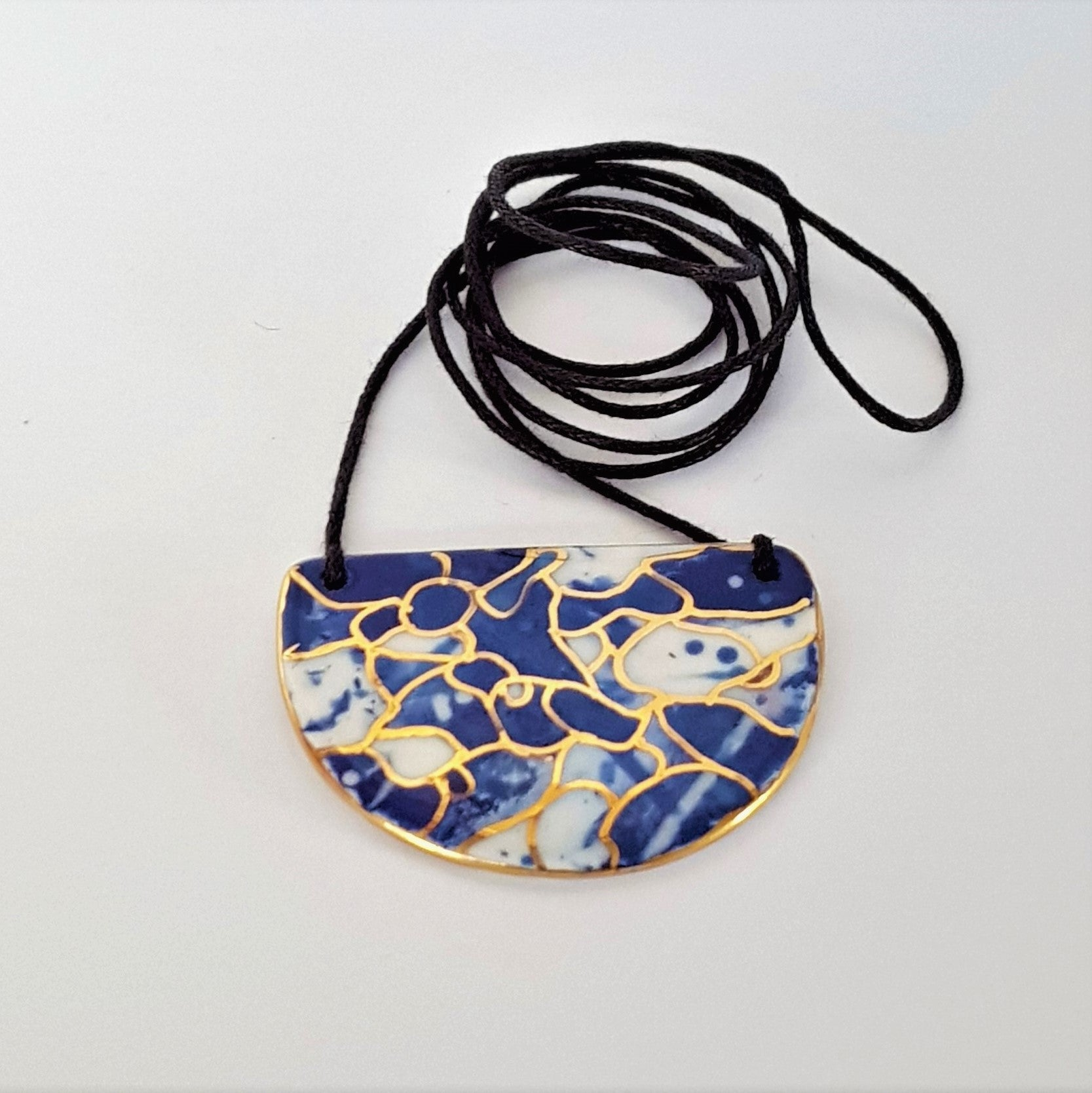 Small half moon pendant indigo tones with gold linework
