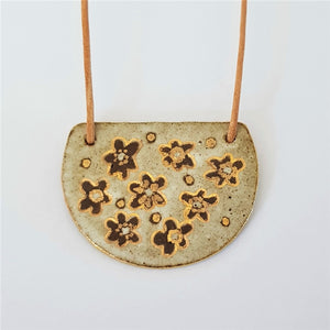 Large earthy matte white floral pendant with gold detailing