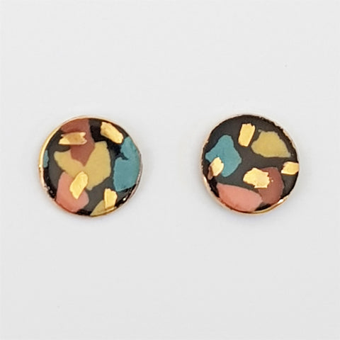 Black terrazzo round studs with gold.