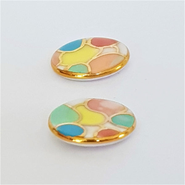 porcelain studs in bright pastel shades with gold detailing