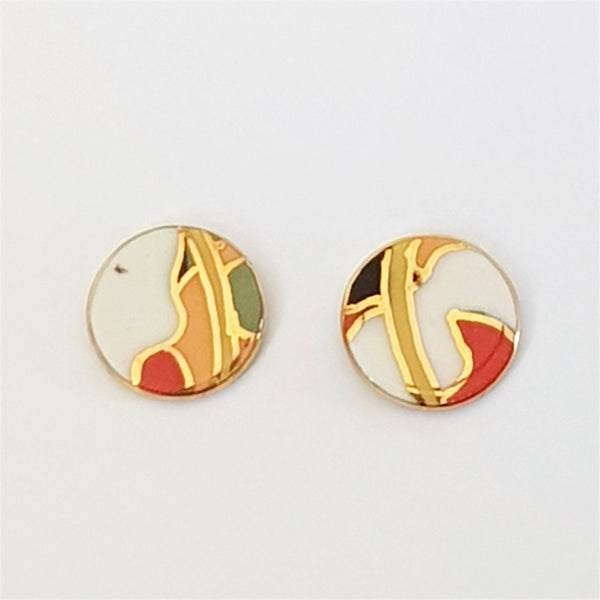 round porcelain stud earrings in abstract pattern with gold