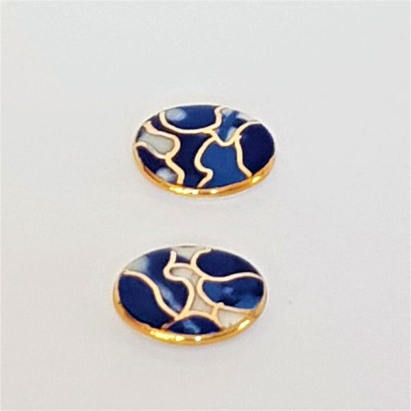 Indigo porcelain studs with gold detailing