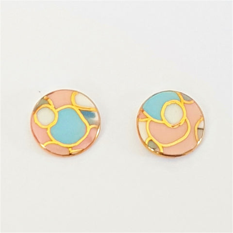 round porcelain studs in soft pink and blues
