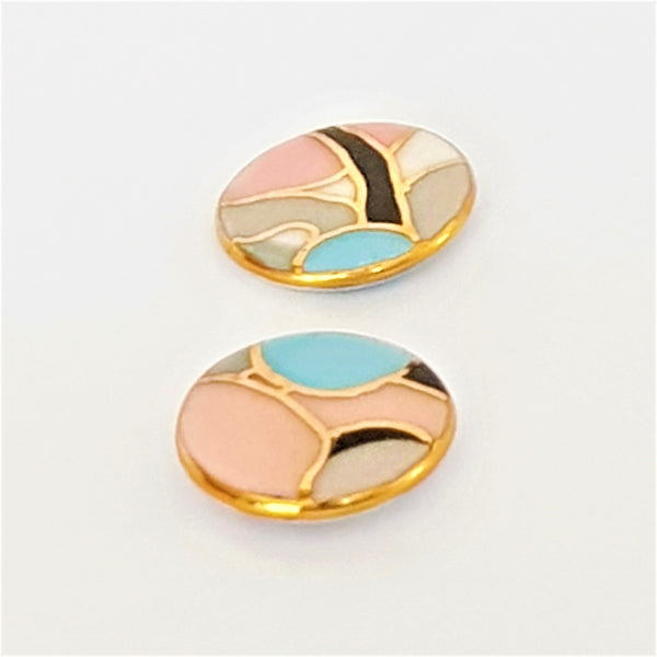 round porcelain studs in soft pink, grey and blue with 22kt gold linework