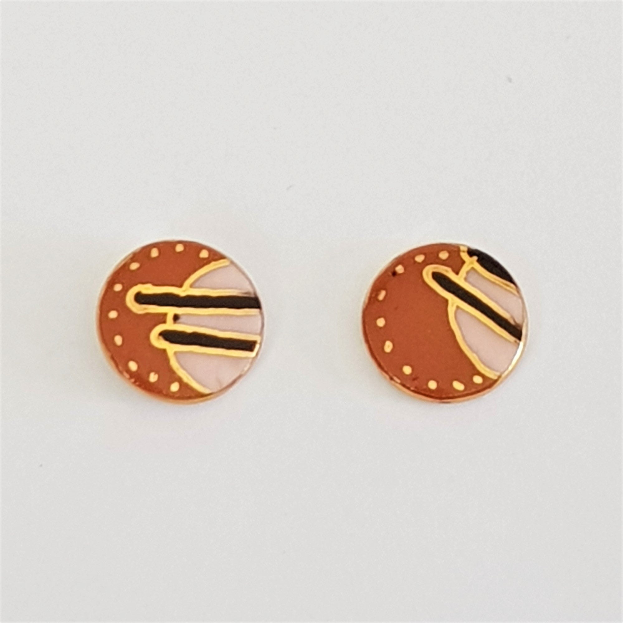 small round studs in earthy colours with gold