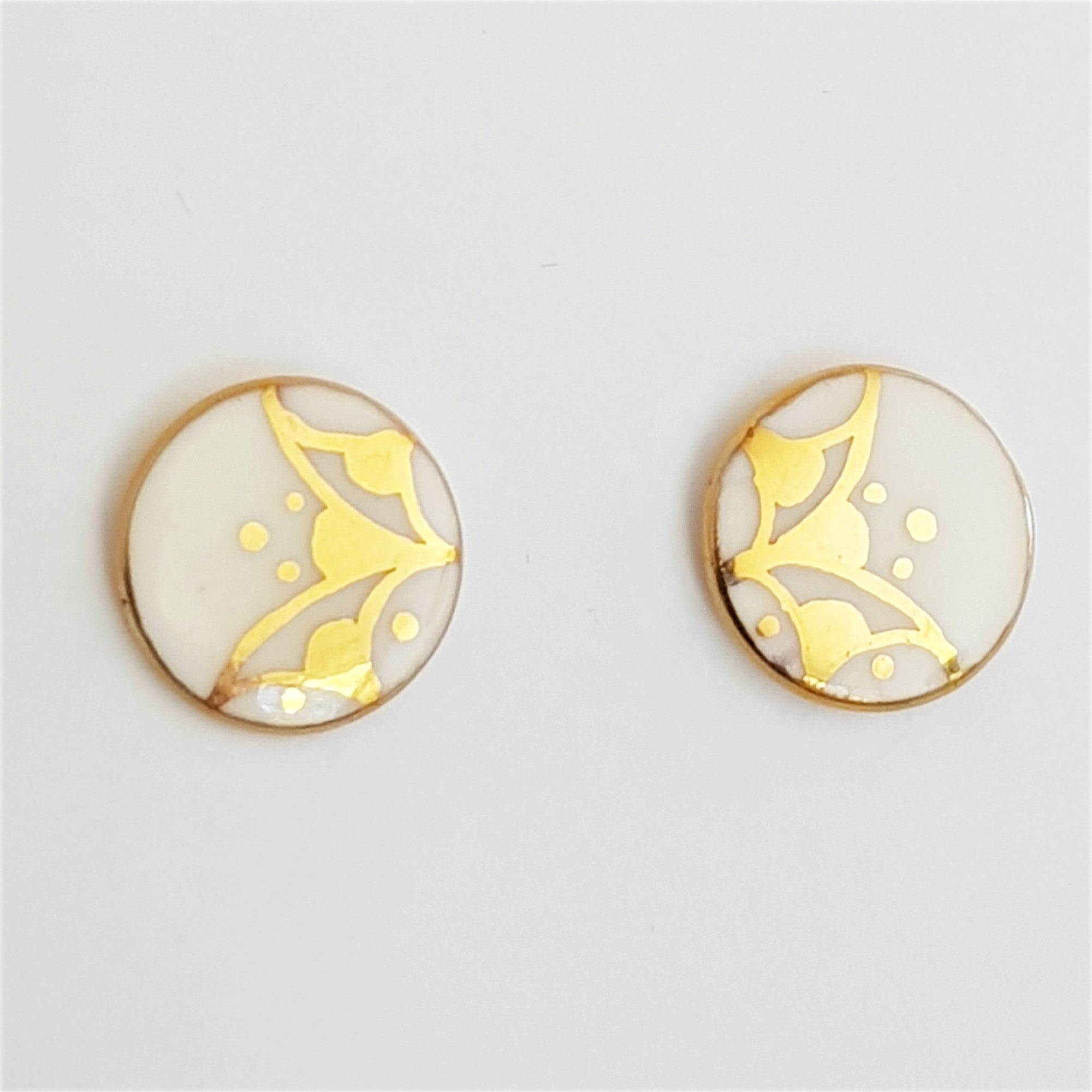 small white porcelain studs with gold design