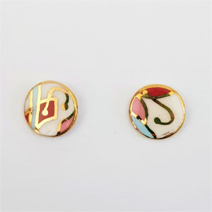 Tiny studs, abstract with red and gold linework.