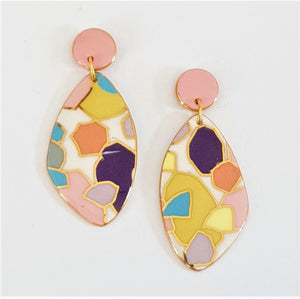 Beautiful wing shaped porcelain earrings in an abstract pastel pattern with gold