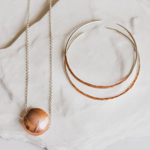 Dillon Rose copper orb necklace. Red Dirt Relief Fund.