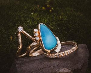 3 ring stack of 14K yellow gold with Turquoise & diamonds. Tulsa custom engagement rings. Dillon Rose wedding.