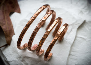 Hammered copper hand forged cuffs