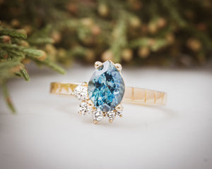 1.5 Carat Montana Sapphire and diamond 18K gold engagement ring. Tulsa engagement ring. Custom jewelry.