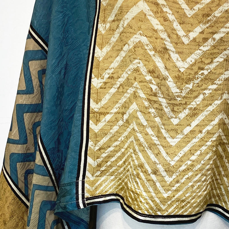 Zebby Pure Silk Capelet Poncho - sariKNOTsari slow fashion bryn walker linen Hamilton sustainable fashion gifts sari not sari Hamilton Fair trade  Ethical  Artisan made  Zero waste  Up-cycled Slow Fashion  Handmade  GTA Toronto Copper Pure Upcycled vintage silk handmade recycled recycle copper pure silk travel clothing hamilton vacation cruisewear resortwear bathing suit bathingsuit vacation etsy silk clothing gifts gift dress top pants linen bryn walker alive intentions kaarigar elephants