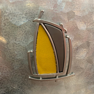 Yellow leather brooch.