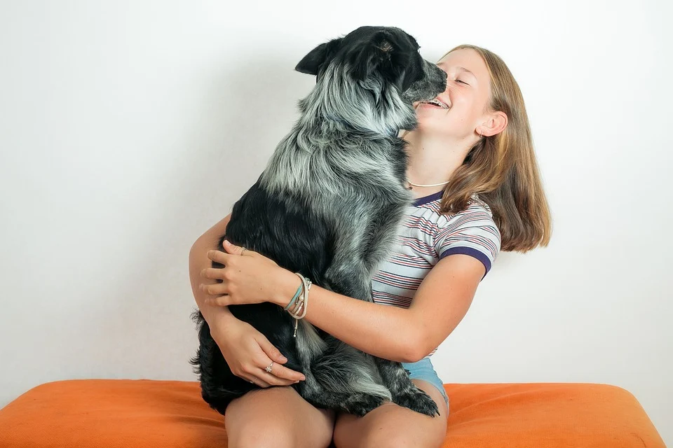 A girl is hugging her dog