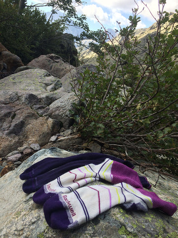 Sockwell socks air drying on a rock