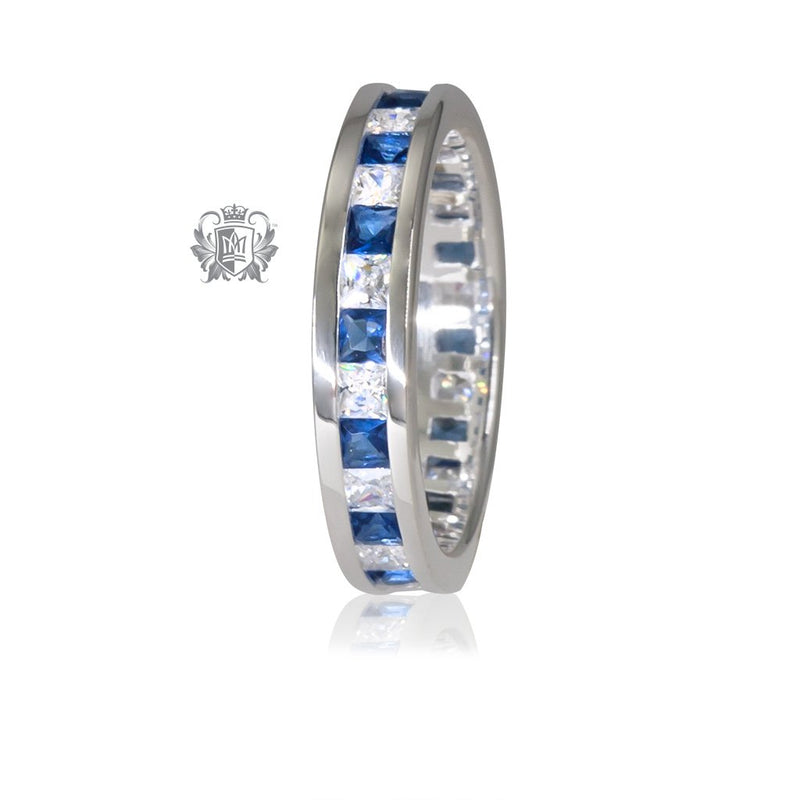 Sapphire and clear cubic eternity band.