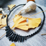 Hand knotted macrame necklace with deep blue raw ratural stone points.