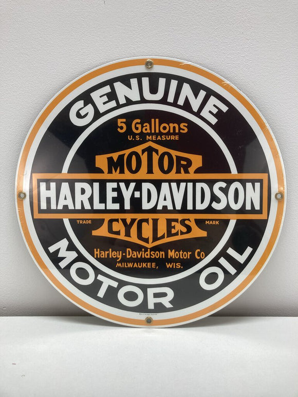 Round metal oil sign