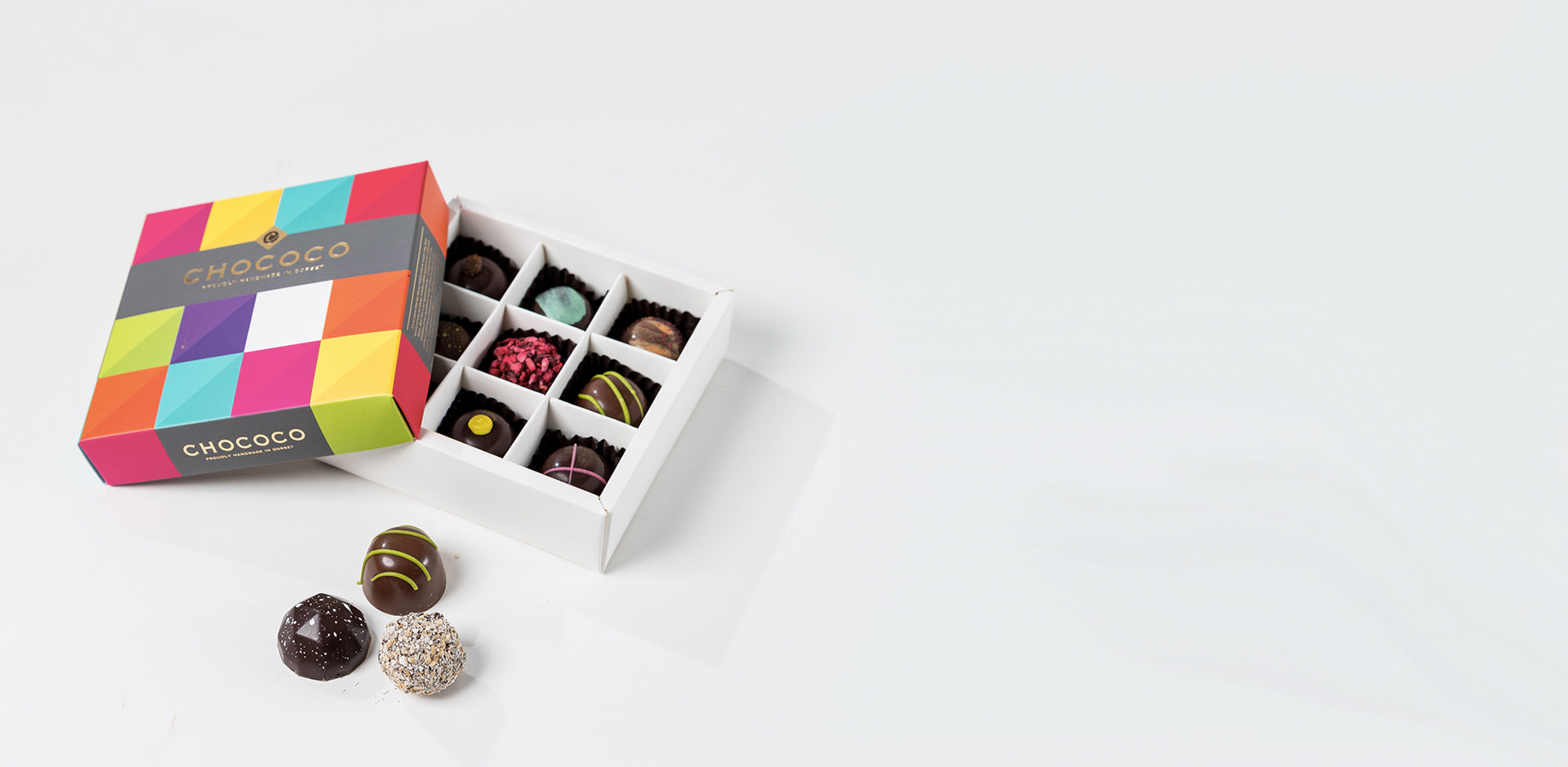 Photograph of a 9-piece Chococo selection box available to order from ChocoCake positioned to the left
