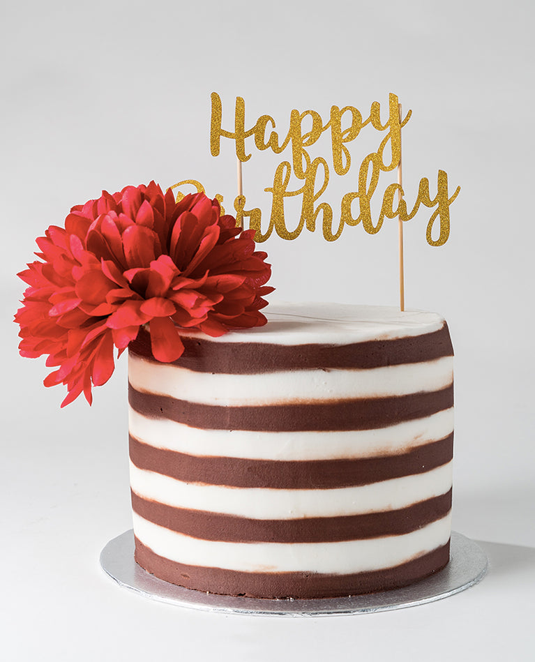 Photograph of a two-tone buttercream cake from ChocoCake positioned to the left