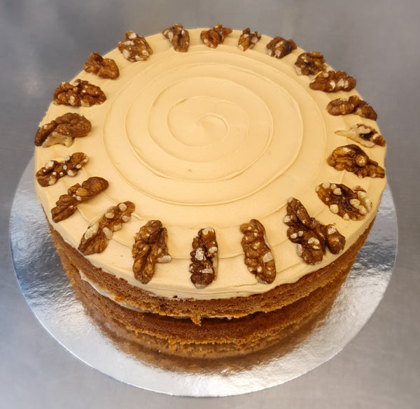An indulgent Coffee Sponge Cake covered in Coffee flavored Buttercream.