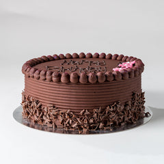 Photograph of a Chocolate Buttercream Celebration Cake with decoration available to order at ChocoCake