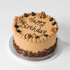 Photograph of a round Coffee Buttercream Cake available to order at ChocoCake with free personalisation and decoration